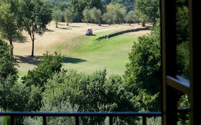 Antico Fienile: Particular view of the golf courses from the bedroom n. 1