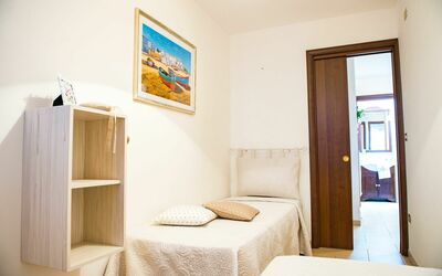 Appartamento Pineta Mare: Second bedroom with 2 single beds