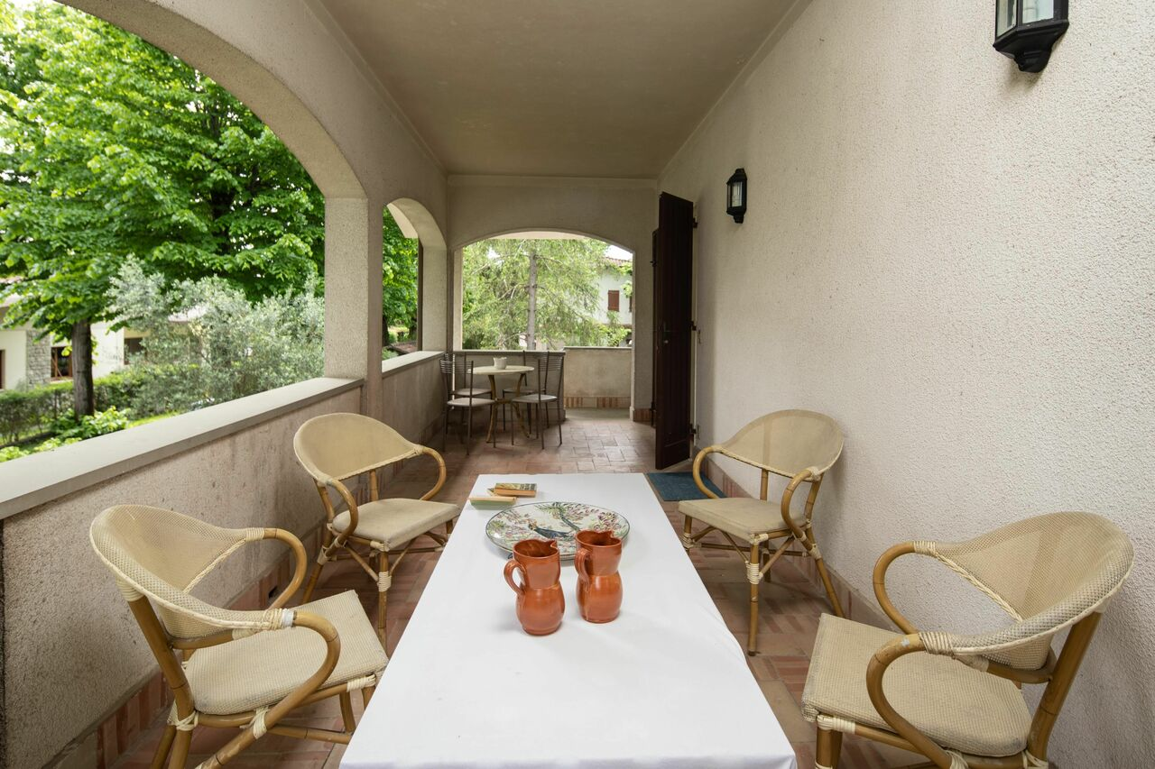 The covered terrace with dining table